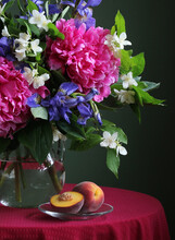 Luxurious Bouquet Of Peonies, Irises And Jasmine And Peaches.