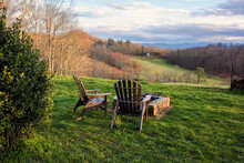 Adirondack Chairs With A Scenic View Of The Countryside