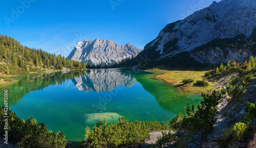 pictorial colorful autumn landscape, tirolean alps, lake Seebensee and zugspitze mountain
