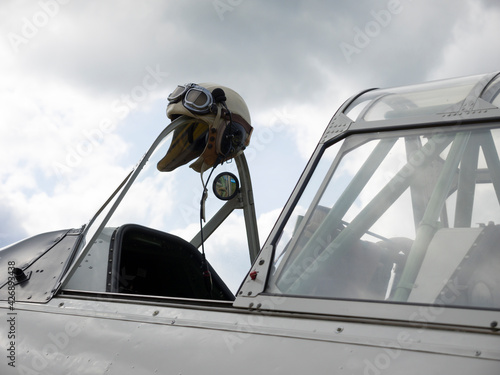 Canvas Classic aviator hat on an airplane windshield