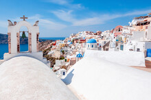 White Houses And Traditional Church In Oia Village, Santorini, Greece