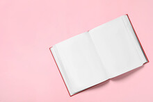 Open Book With Blank Pages On Pink Background, Top View. Space For Text