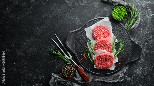 Raw cutlets for a burger with spices. Meat. Top view. Free space for your text.