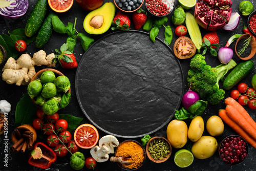 Fotografia, Obraz Fresh vegetables and fruits: fennel, avocado, pomegranate, berries, cabbage and basil