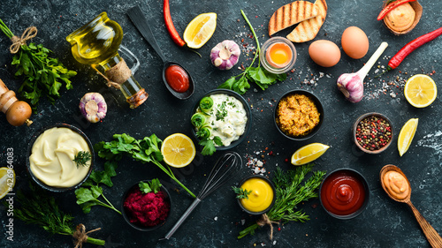 Fotografie, Obraz Set of sauces and spices on stone background