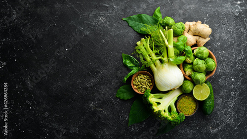 Canvas Print Fresh green vegetables and spices: fennel, avocado, cucumber, lime, cabbage and basil