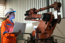 Asian Female Engineer Specialist With Measuring Machine With A Manipulator Arm.Three-dimensional Coordinate Measurement. Check Sizes. 3D Check Of The Sizes Of Parts. CMM After Machining Process