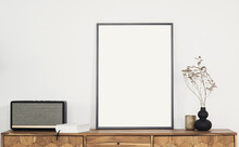 Blank Picture Frame Mockup On White Wall. Living Room Design. View Of Modern Retro Style Interior With Flowers. Home Staging And Minimalism Concept. Artwork Poster Showcase