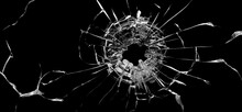 Bullet Hole In The Glass. Isolated On A Black Background.