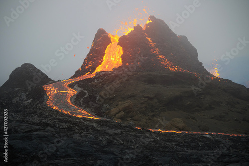 Fototapeta Side shot of a volcano crater formed in the volcanic eruption in a valley called Geldingardalir in Iceland
