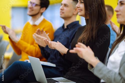 Obraz na plátně Group of people take notes,  listening to a lecturer or speaker at a conference