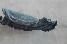 Flying Grey Blanket On Grey Background. Craft Rug For Cold Winter