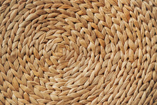 Woven Rattan. Weaving Circle Pattern Background. Detail And Texture Of Traditional Handicraft. Natural Basketry Material.