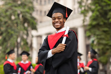 Cheerful African American Guy In Graduation Costume