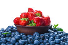 Blueberries And Strawberries Background.