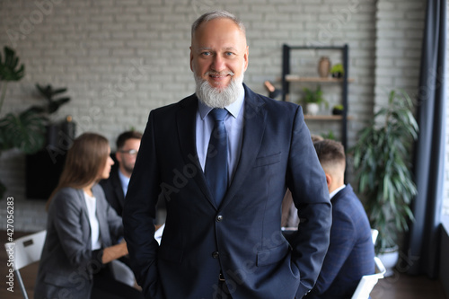 Fototapeta Businessman with colleagues in the background in office.
