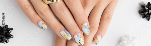 Young adult woman's hands with fashionable nails on white background. Manicure, pedicure beauty salon concept.