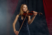 Female Violonist With Bow And Violin, Solo Concert