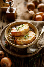 Traditional French Onion Soup Baked With Cheese Croutons Sprinkled With Fresh Thyme.