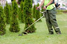 Man Gardener Worker Changing Landscape With String Lawn Trimmer