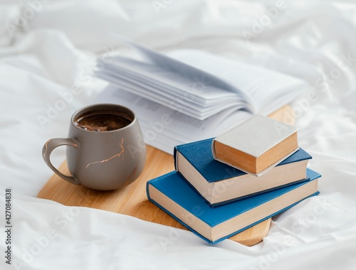 Tableau sur Toile Arrangement with books and cup in bed