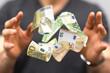 Leinwanddruck Bild - money euro banknote in hand rain