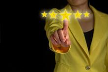 Women Hand In Yellow Suit Hand Touching 5 Star Symbol