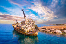 Abandoned Ship Off Coast Of Cyprus. Rusty Ship Next To Paphos Beach. Abandoned Ship In Mediterranean Sea. Paphos City Guide. Remains Of Vessel In Cyprus. Excursions Along Cyprus Coast.