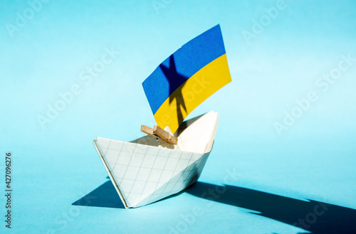 Wallpaper Mural shadow of the Moscow Kremlin over the flag of Ukraine, relations conflict betwee