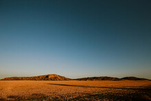 Vibrant Sunset Landscape Image Of Mount Hope Surrounded By Wheat Fields With Kangaroos Visible