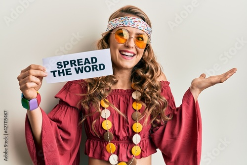 фотография Young blonde girl wearing bohemian and hippie style holding spread the word mess