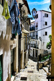 Fototapeta Uliczki - Old colorful houses and narrow streets of Lisbon