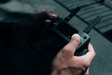 Drone Remote Control. Remote Control In Hand Man. Man Holds Remote Controller With His Hands And Controls The Drone