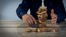 Project Management Strategies In Business And Gambling Engineers Place Wooden Blocks On Towers, Business Ideas And Risky Construction.
