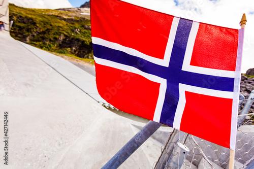 Fototapeta Norwegian flag on Utsikten viewpoint