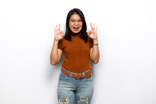 OK Sign Gesture Of Young Beautiful Asian Women Dress Orange Shirt Isolated On White Background