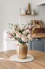 Spring Bouquet On The Table In The Style Interior In Living Room. Scandinavian Style. White Wooden Background. Bright  Interior. Cat In The Living Room.