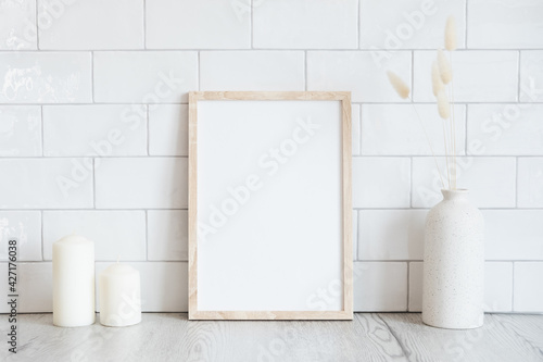 Fototapeta Interior design of living room with mockup photo frame, dried flowers in vase, candles