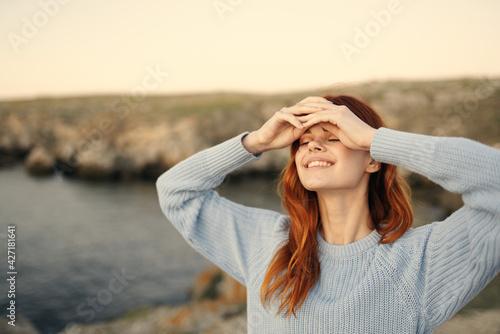 pretty woman in blue sweater enjoy nature fresh air freedom - fototapety na wymiar