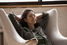 Close Up Mindful Relaxed Woman With Closed Eyes Sitting In Cozy Armchair, Stretching, Enjoying Lazy Weekend At Home, Peaceful Attractive Young Female Leaning Back, Taking Nap, Sleeping Or Daydreaming