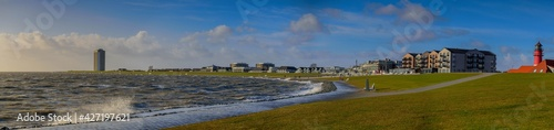 Fotografie, Obraz Panorama view of Büsum promenade  by high tide on the North sea coast, Dithmarschen, Schleswig-Holstein, Germany