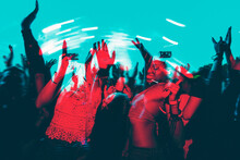 People Dancing In A Music Festival In Double Color Exposure Effect