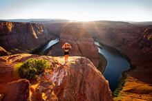 Woman On Horseshoe Bend And Colorado River. Famous Hiking Place. Grand Canyon, Glen Canyon, Arizona. Arizona Horseshoe Bend Of Colorado River In Grand Canyon. Travel And Adventure Concept.