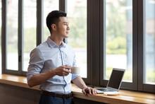 Businessman Drinking Coffee In Caf��