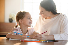 Smiling Little Girl Child Have Fun Drawing Painting With Caring Young Caucasian Mother At Home. Happy Mom And Cute Small Daughter Enjoy Creative Art Activity Together. Hobby, Creativity Concept.