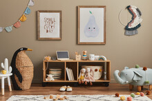 Stylish Scandinavian Kid Room Interior With Toys, Teddy Bear, Plush Animal Toys, Mint Pouf, Furniture, Decoration And Child Accessories. Brown Wooden Mock Up Poster Frames On The Wall. Template