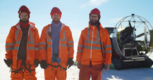 Professional Lifesavers Putting On Hardhat Working In Arctic