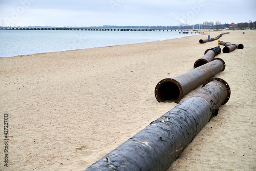 Fotografering Pressure silting pipes on the beach of Sopot