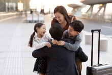 Happy Young Family At Airport