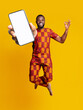 canvas print picture Awesome mobile application. Carefree African American guy in traditional costume jumping up with smartphone, mockup